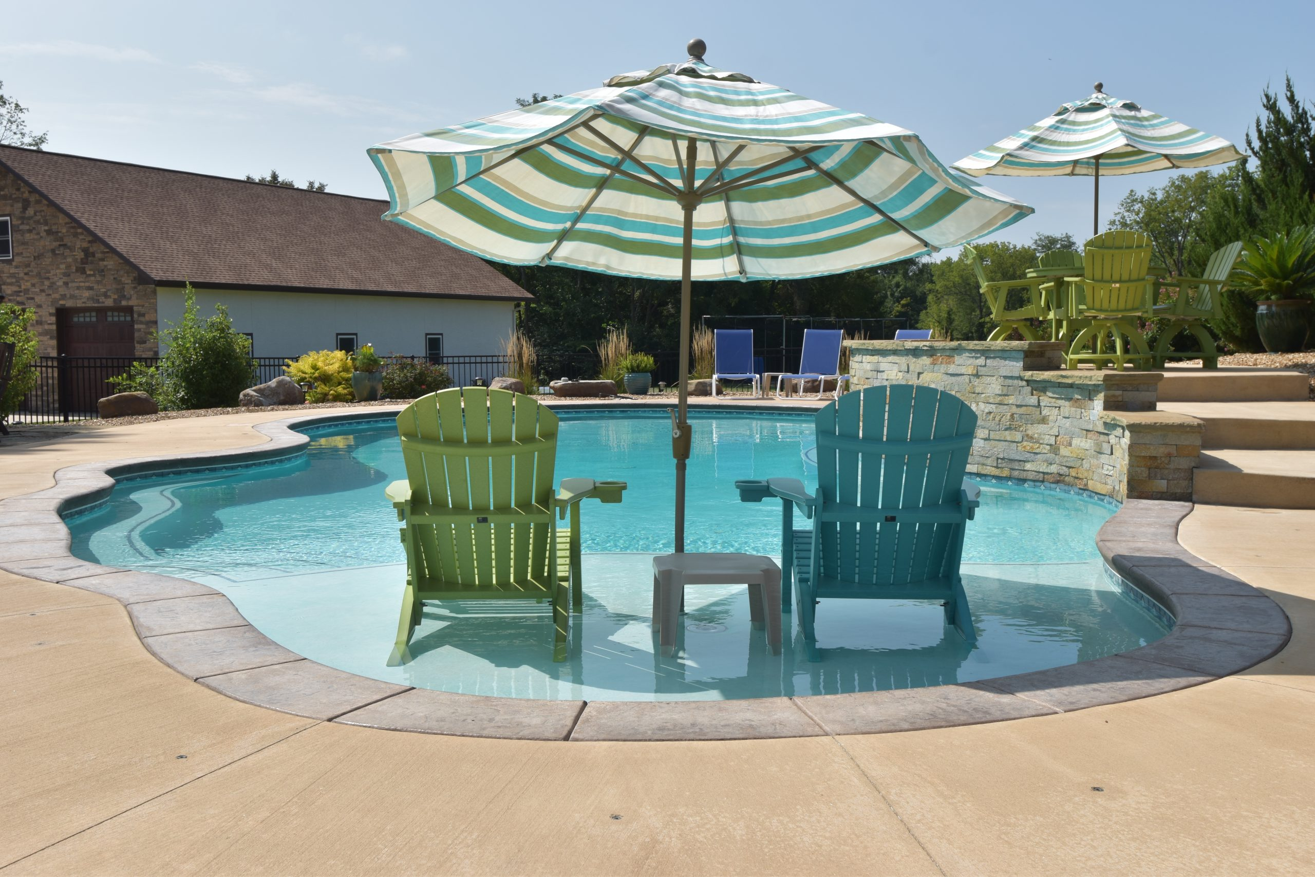 Oasis Pools & Spas pool with chairs
